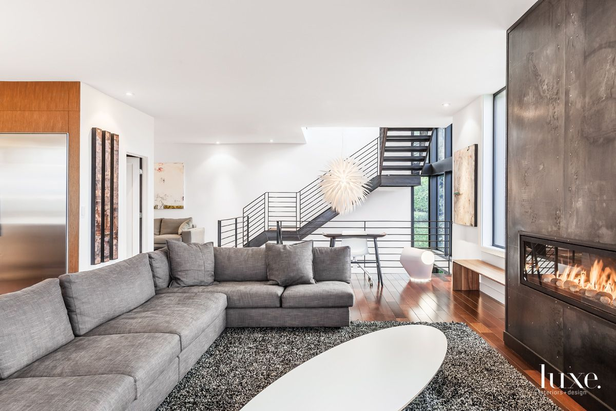 Modern White Living Room with Blackened-Steel Fireplace Surround
