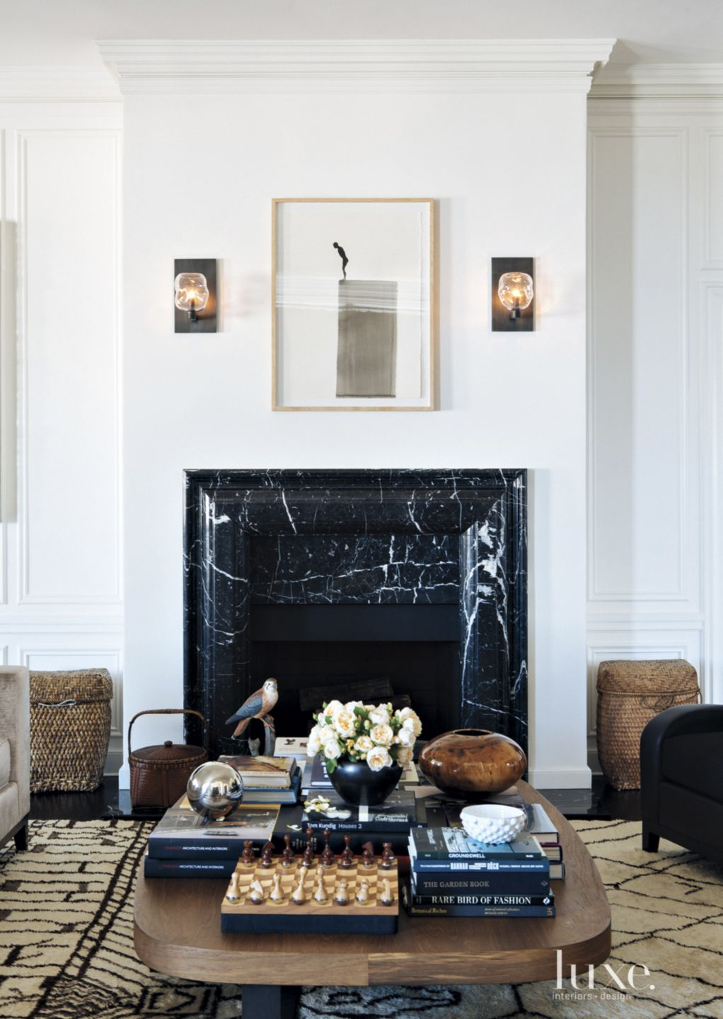 Transitional White Living Room With Black Marble Fireplace Luxe Interiors Design