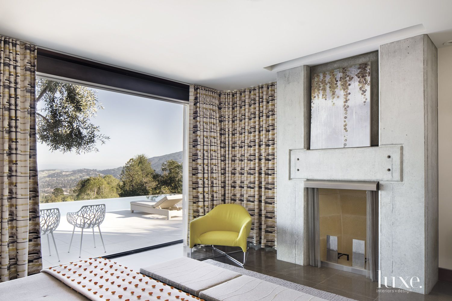 Contemporary Guest Bedroom with Concrete Fireplace