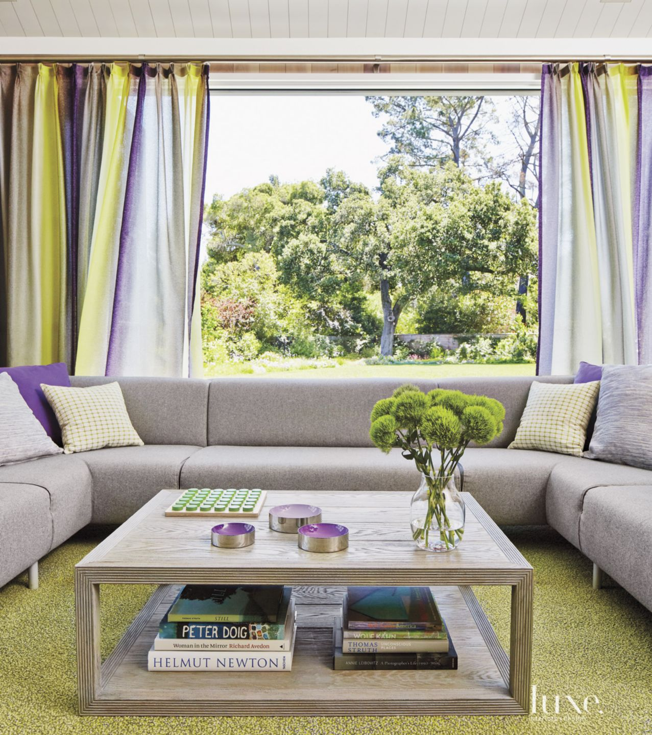 Eclectic Neutral Family Room with Multicolored Drapes