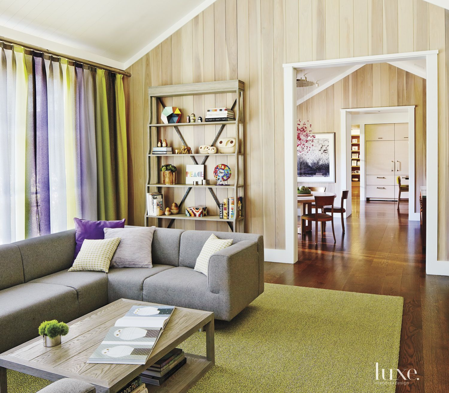 Eclectic Neutral Family Room with Poplar Paneling