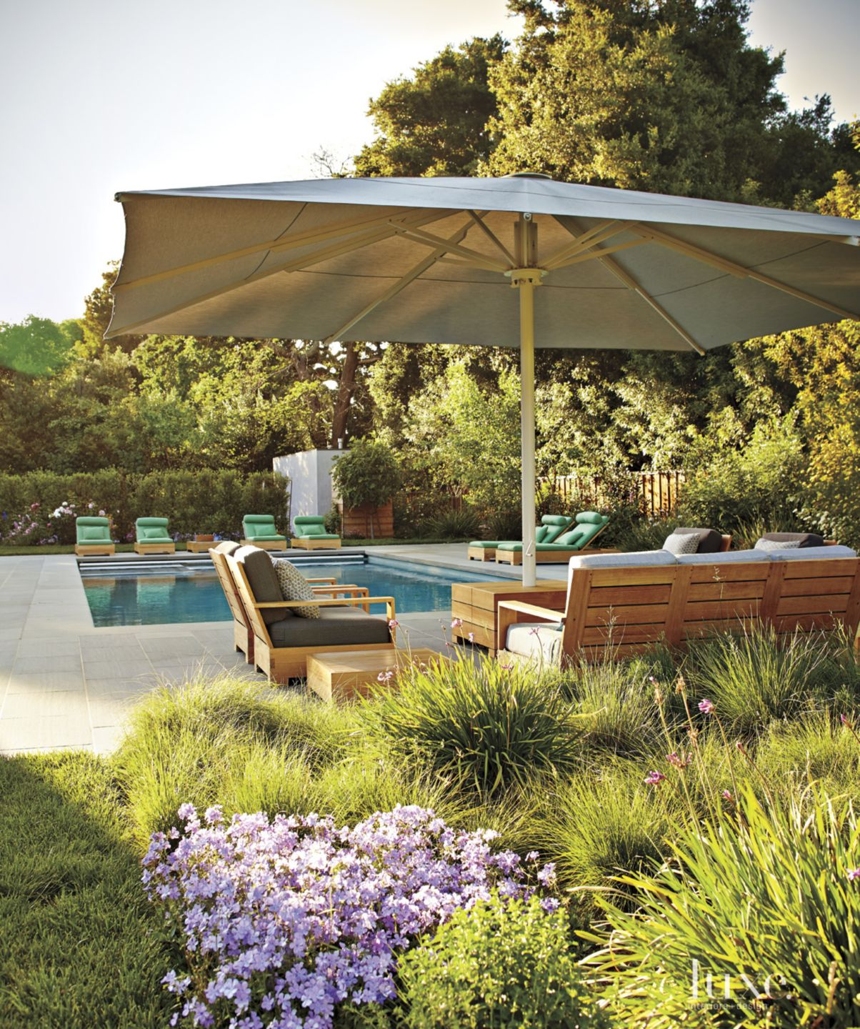 Contemporary Neutral Pool Area with Custom Umbrella Shade