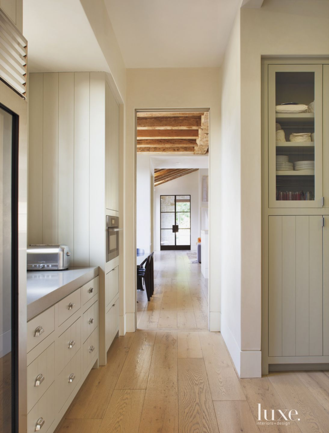 Transitional White Hall with White Oak Floors