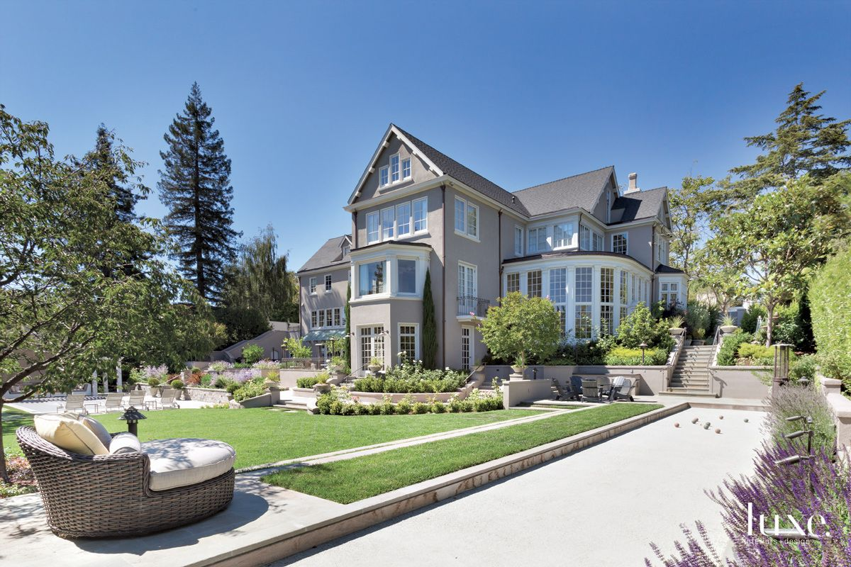 Traditional Gray Rear Exterior with Backyard Landscape