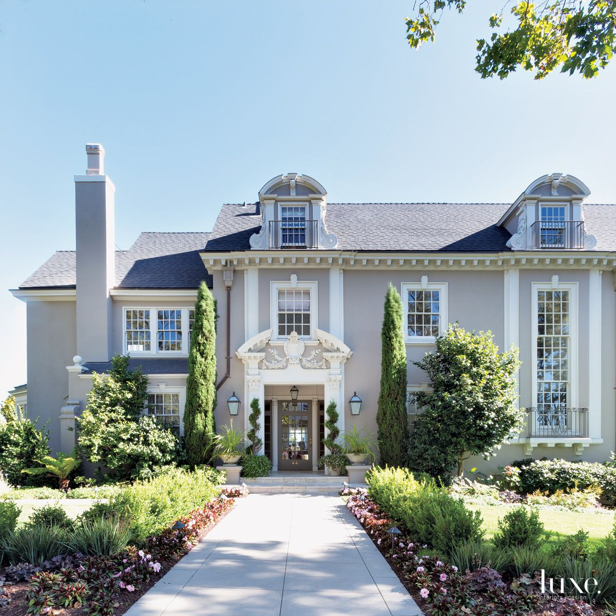 Traditional Gray Exterior with Lush Landscape