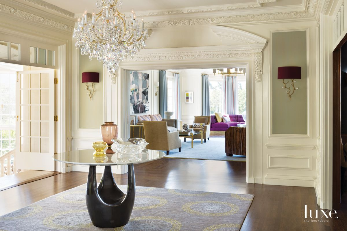 Traditional Cream Entry with Contemporary Furnishings