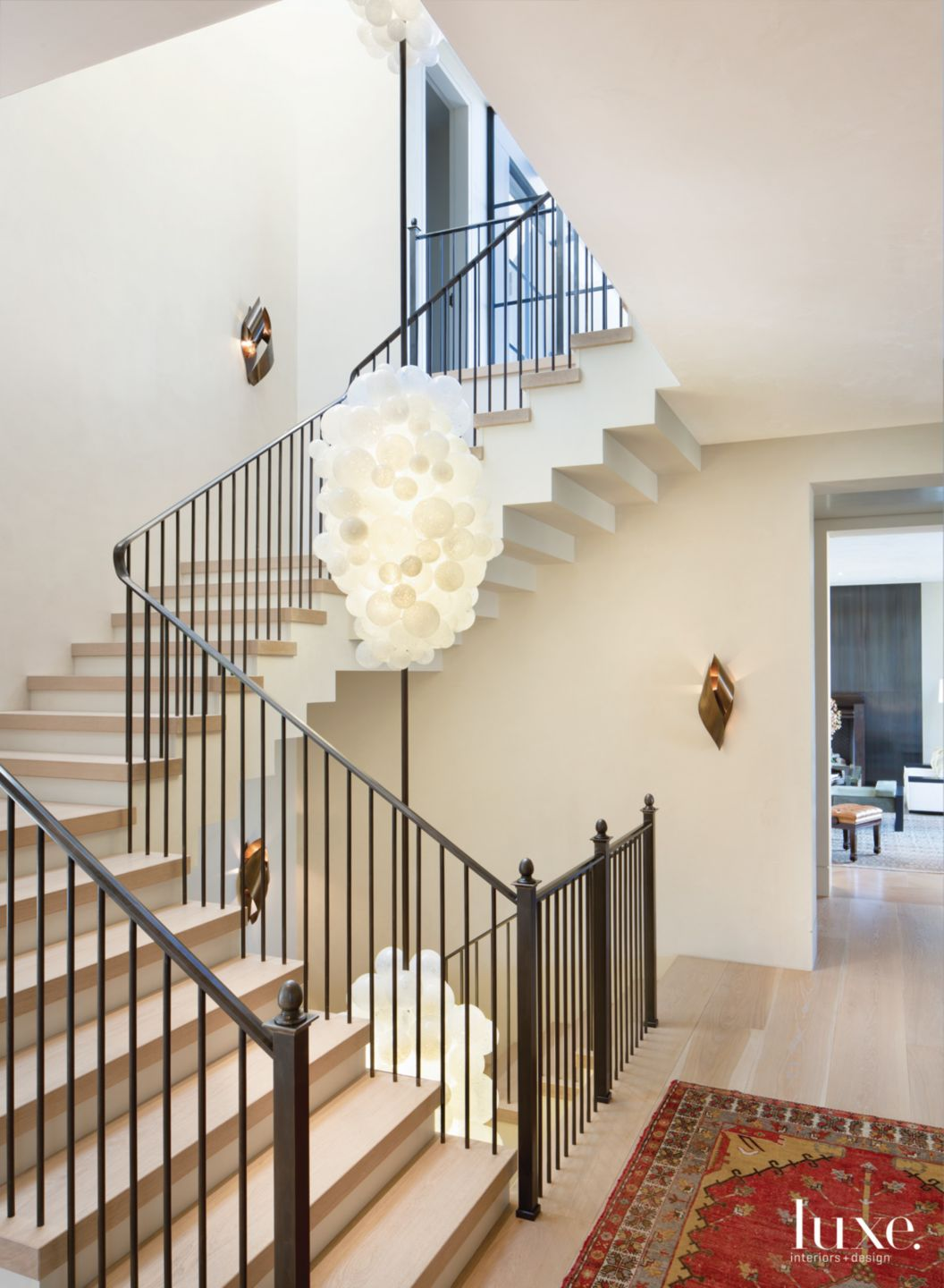 Modern White Staircase with Handblown Fixture