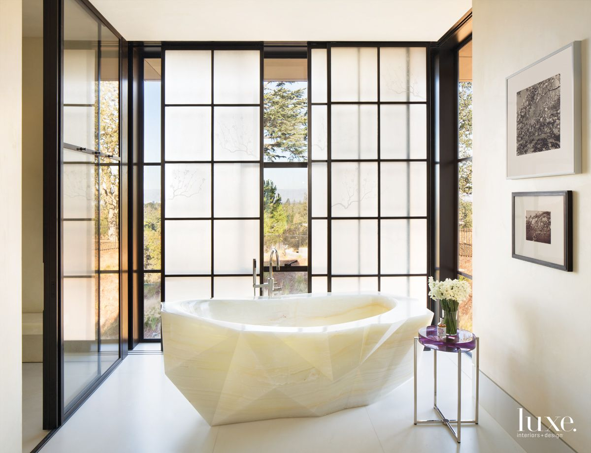 Modern Cream Bathroom with Faceted Onyx Tub
