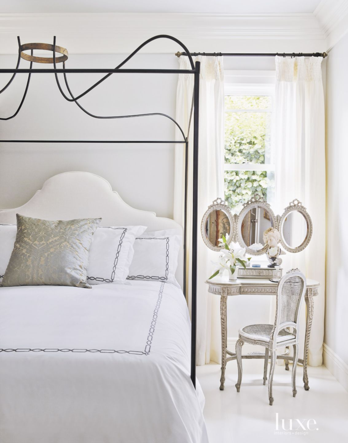 Contemporary White Master Bedroom with Vintage Vanity
