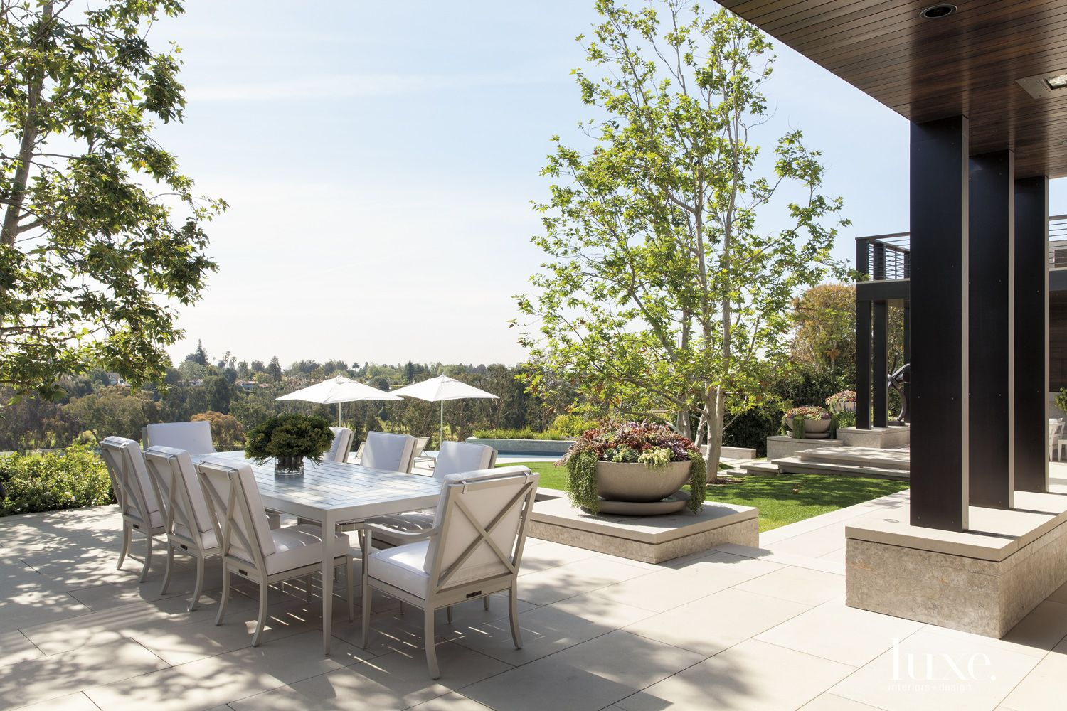 Contemporary Outdoor Dining Area with Custom Planters