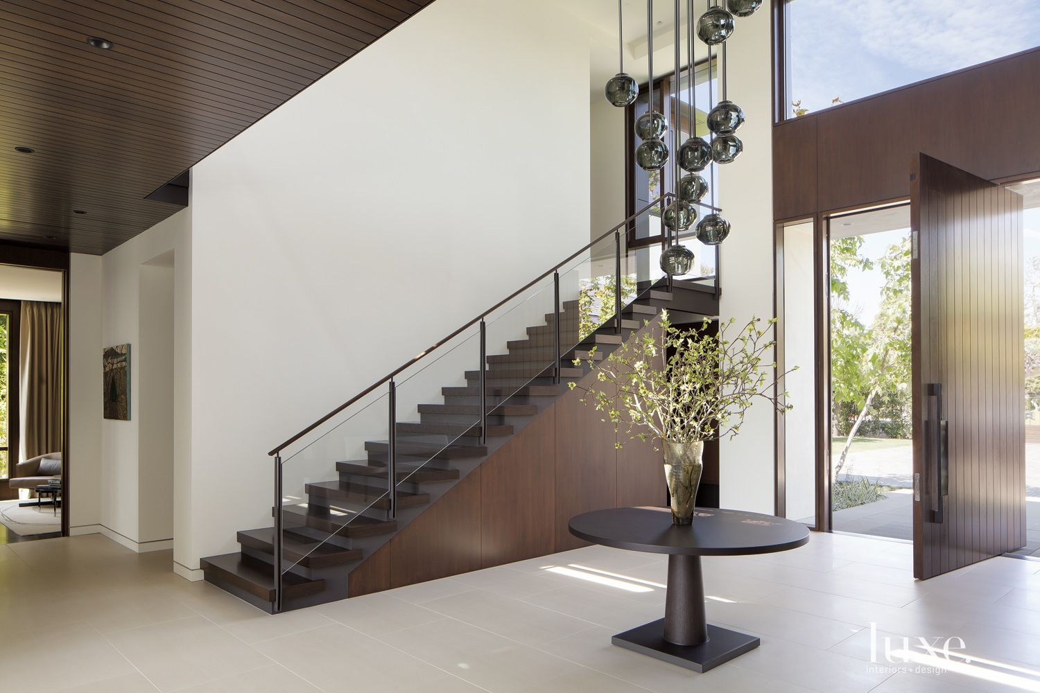 Contemporary White Foyer with Simple Staircase