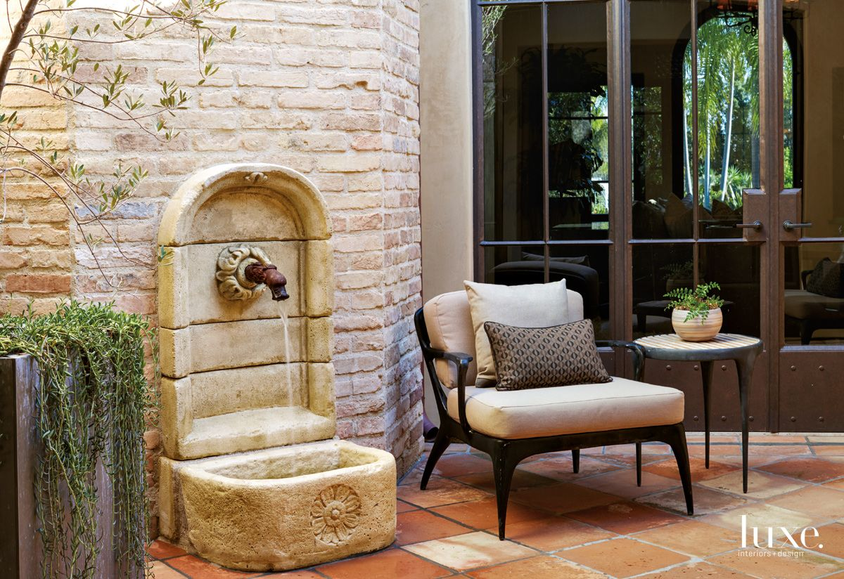 Transitional Neutral Courtyard with Stone Fountain