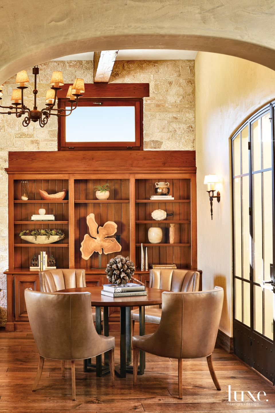 Transitional Neutral Dining Room with Built-In Bookshelves