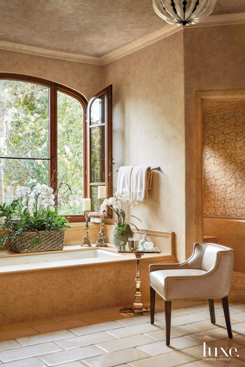 Transitional Neutral Bathroom with Wood-Framed Arched Windowa