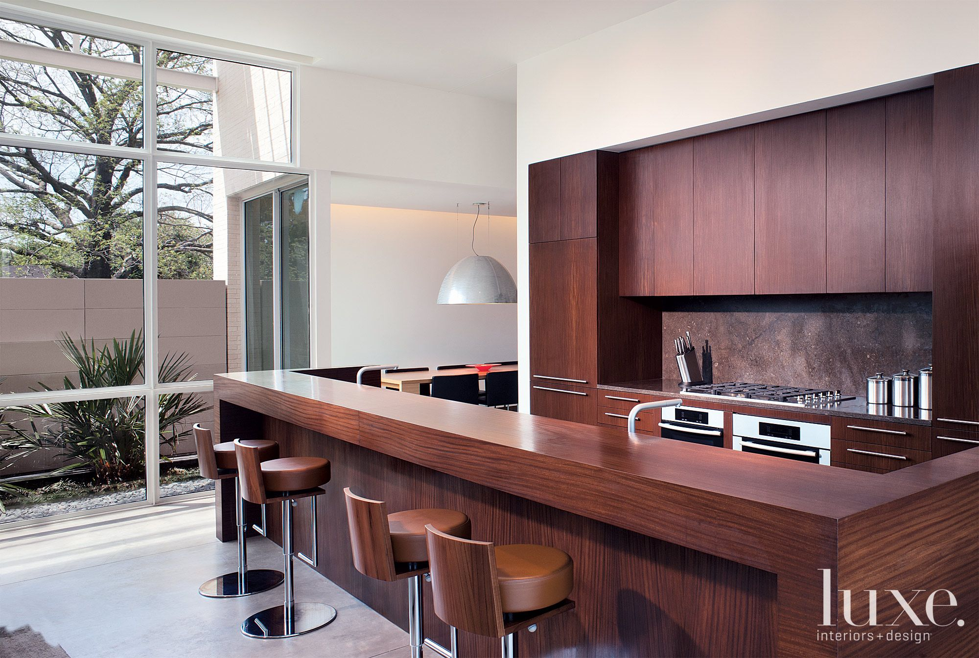 Modern White Kitchen with Afromosia Cabinetry