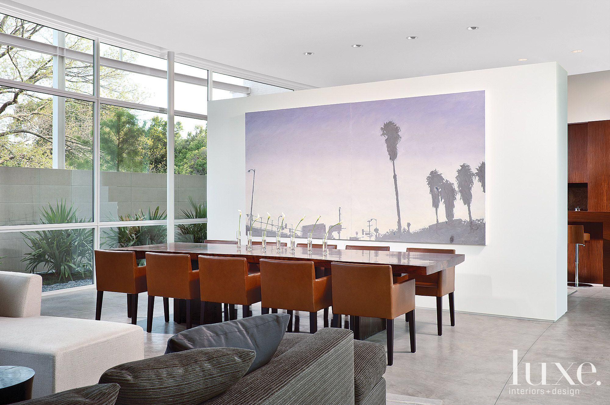 Modern White Dining Area with Freestanding Wall