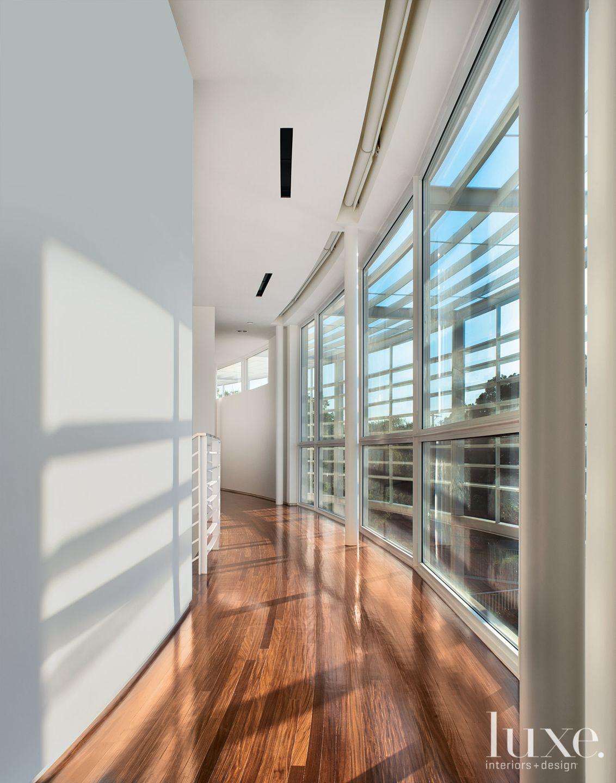 Modern White Hallway with Floor-to-Ceiling Windows