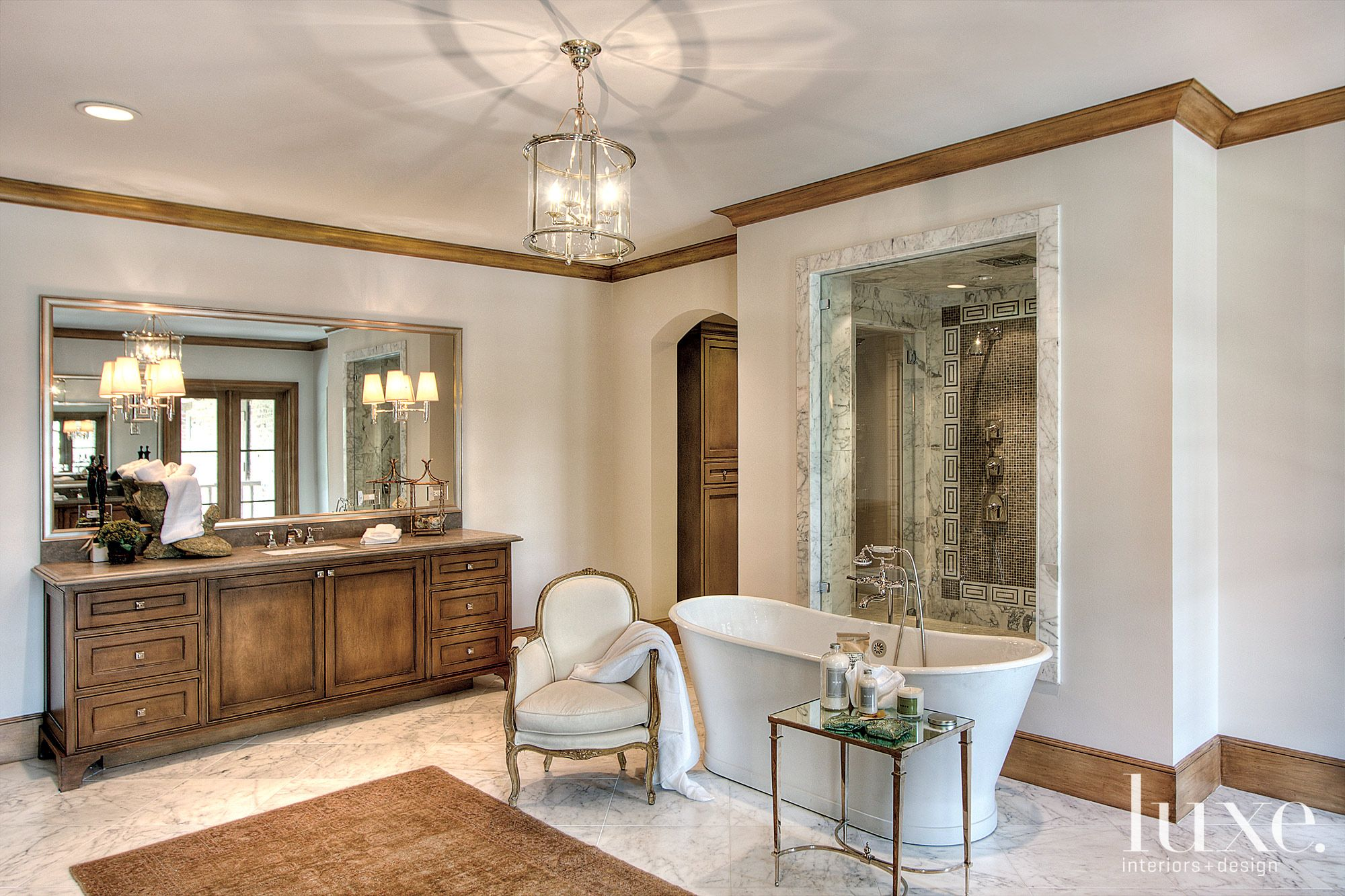 Traditional Cream Bathroom with Bronze Mirrored Table