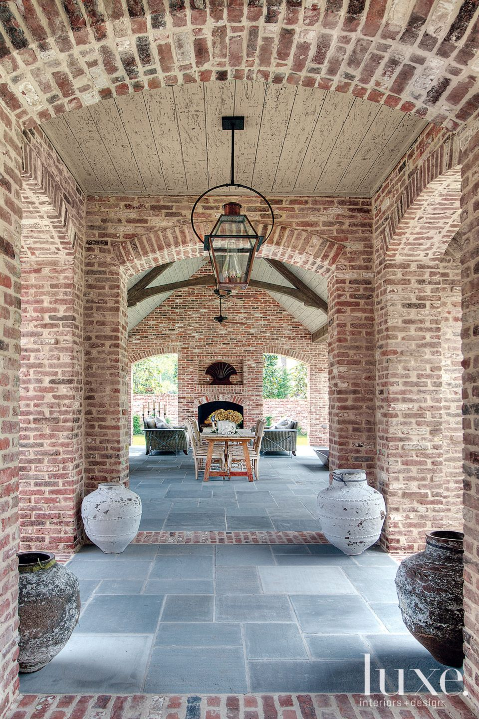 Traditional Brick Loggia with Lantern Pendants