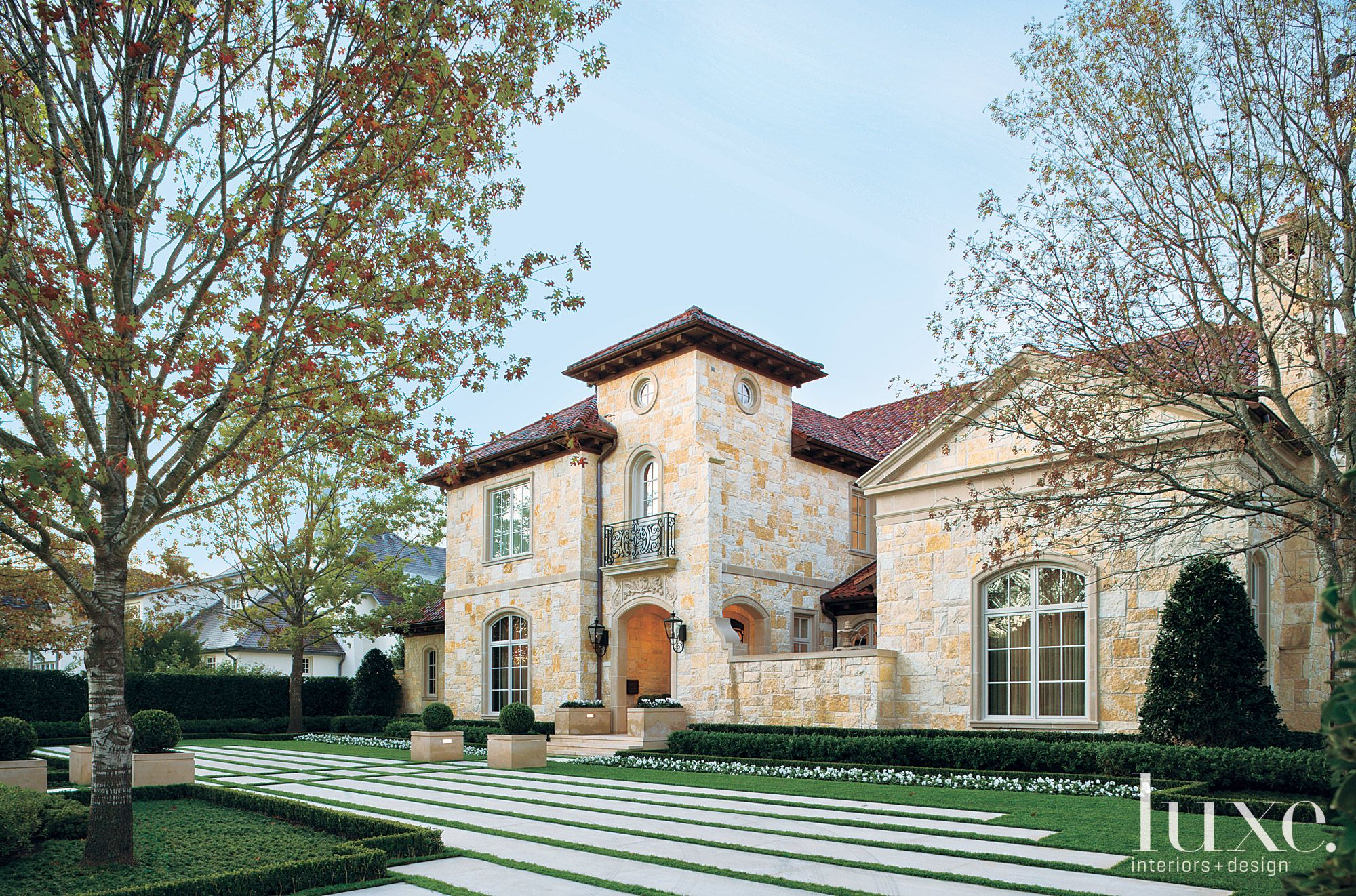 Traditional Neutral Exterior with Tuscan-Inspired Landscape