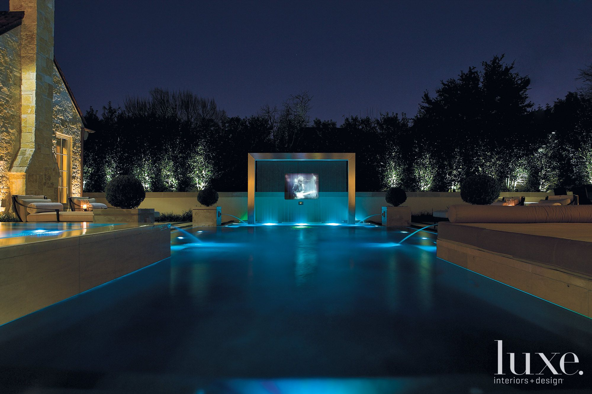 Contemporary Pool Area with Waterfall Projection Screen