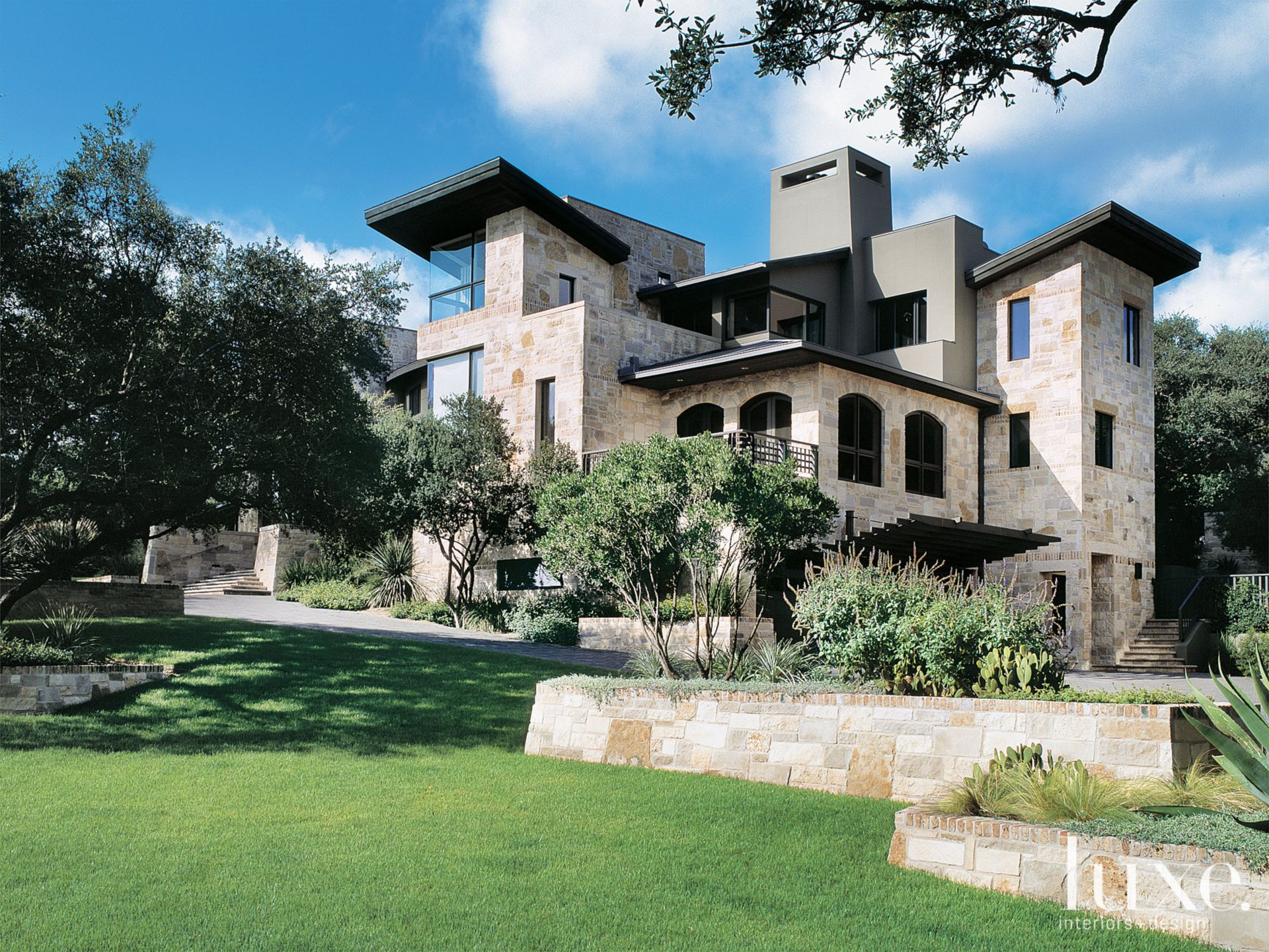 Transitional Limestone and Stucco Exterior with Curated Landscape