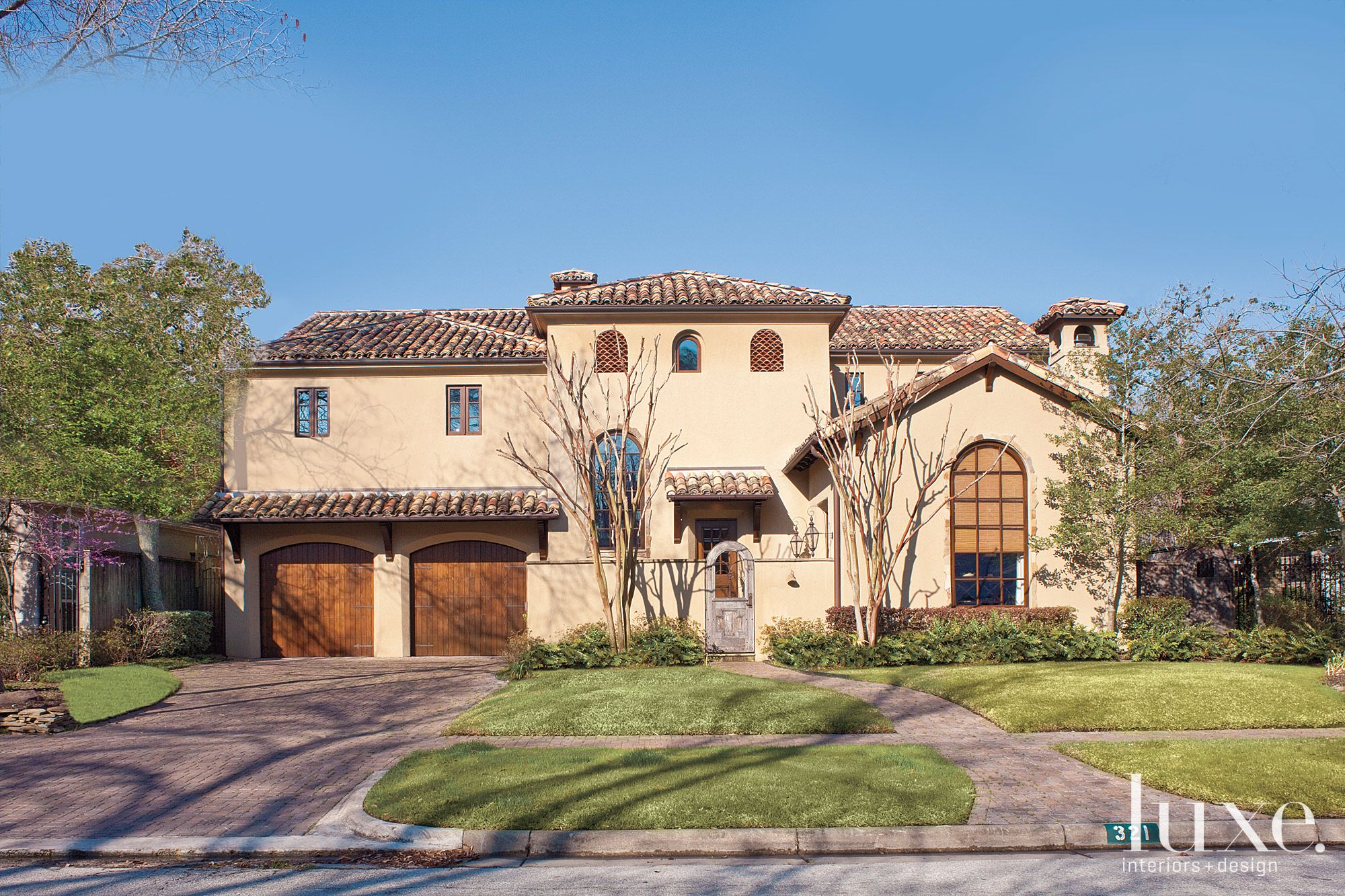 Mediterranean Cream Front Elevation with Arched Gate