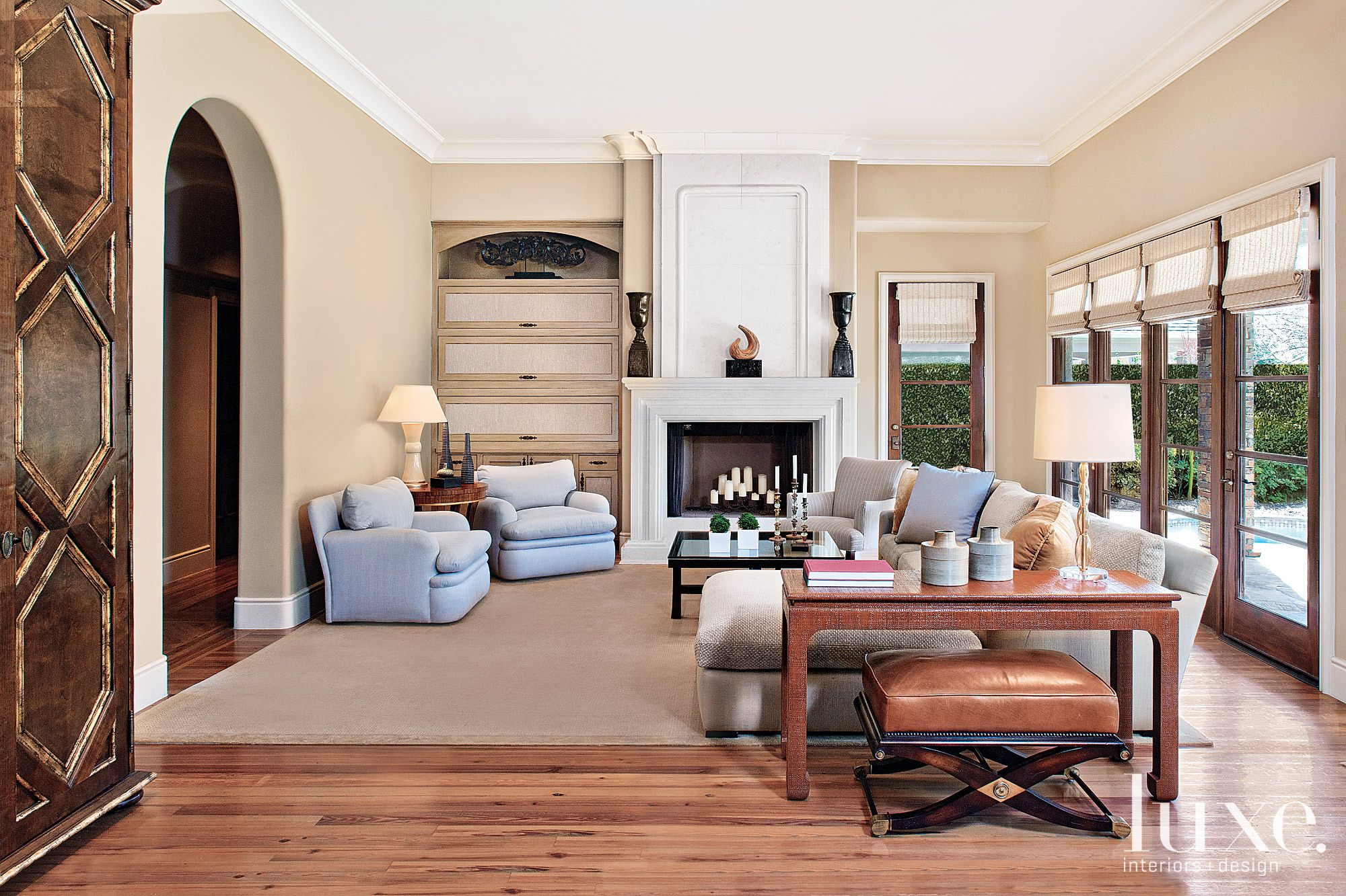 Mediterranean Cream Living Room with Arched Entry