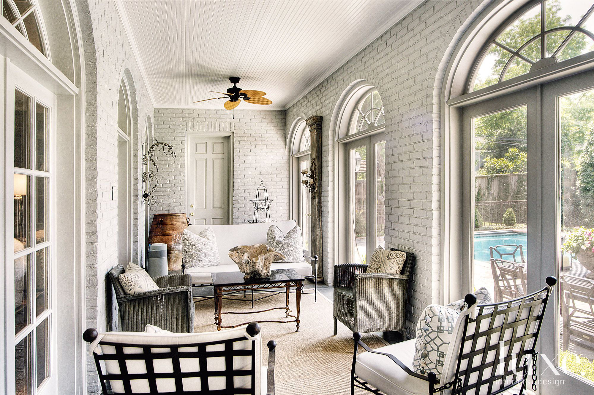 Traditional White Patio with Painted Brick Walls
