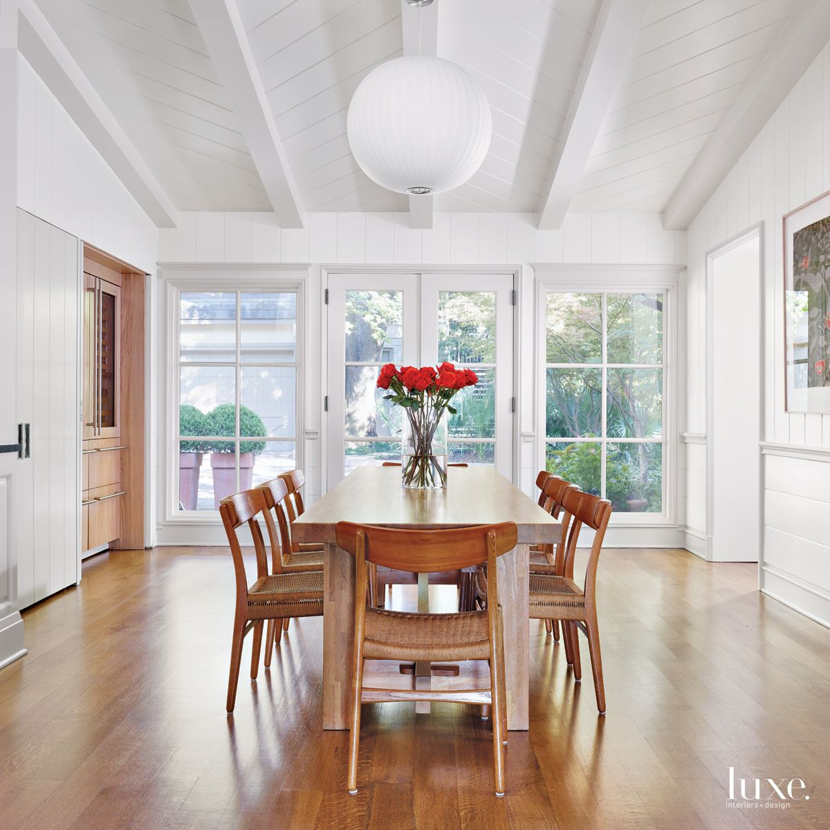 Modern White Breakfast Room with Butcher-Block Farm Table