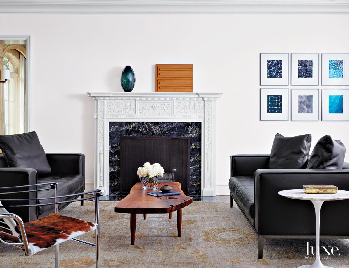 Modern White Living Room with Black Leather Sofas