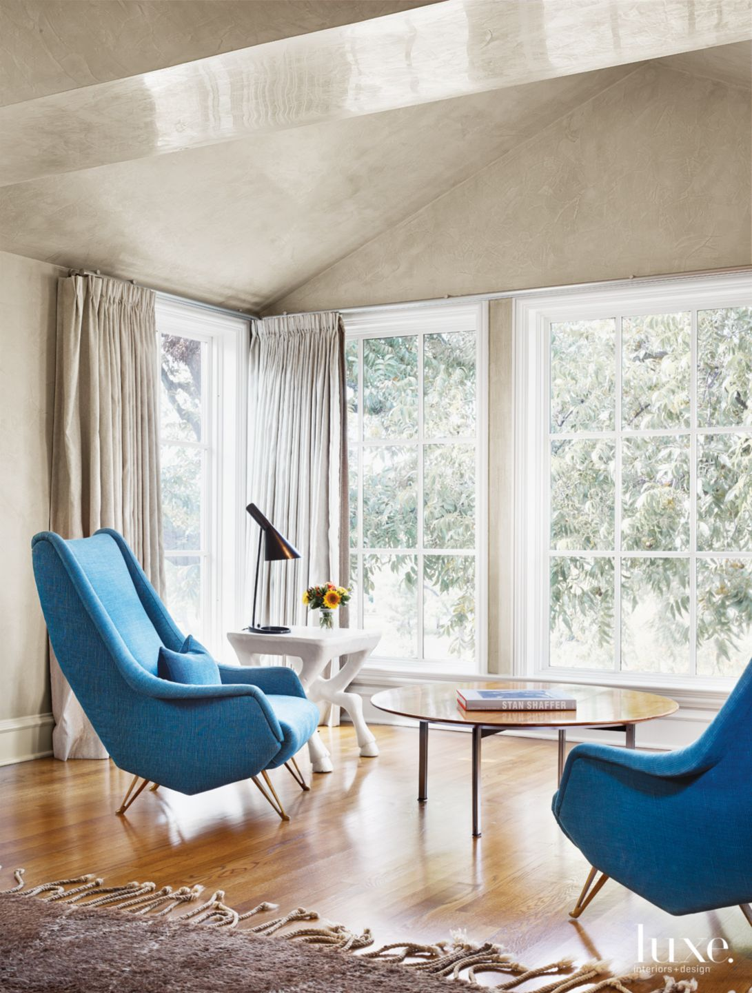 Modern Neutral Bedroom Sitting Area with Blue Midcentury Chairs