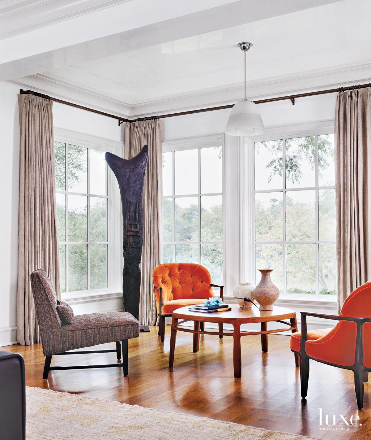 Modern White Living Room Nook with Orange Velvet Chairs