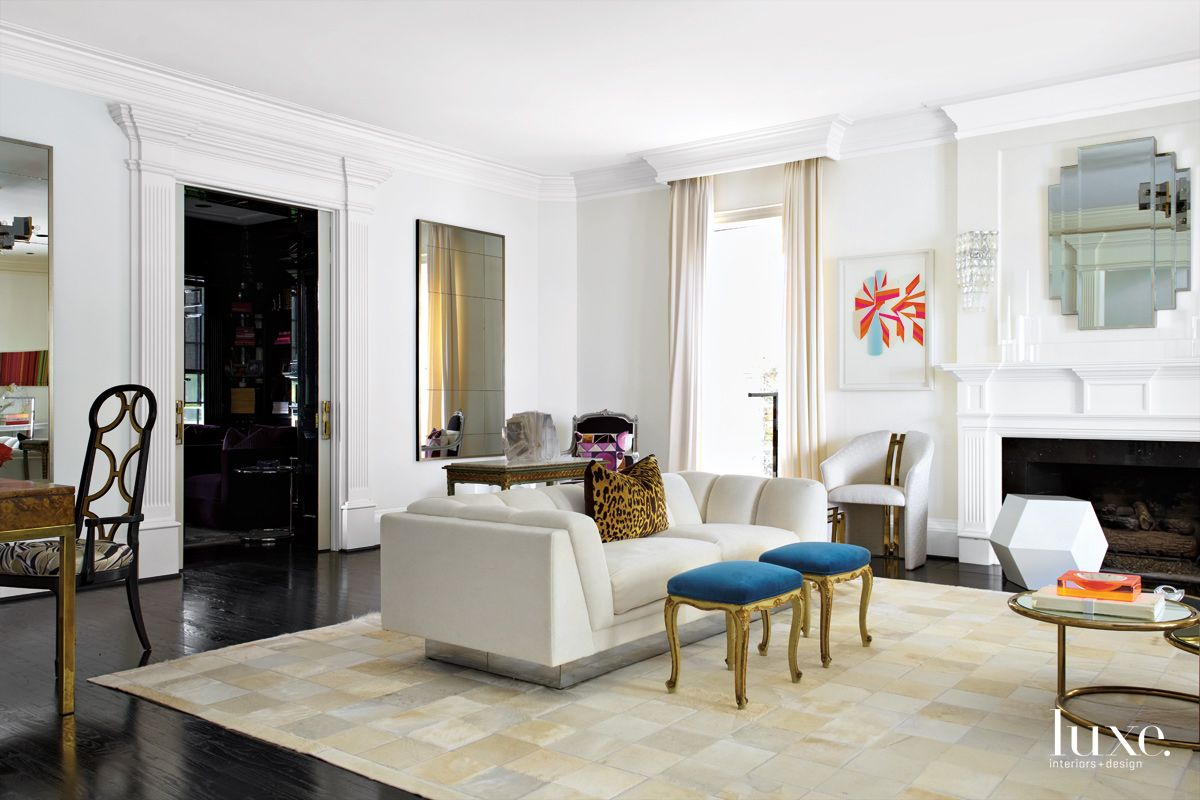 Modern White Living Room with Blue Velvet Stools