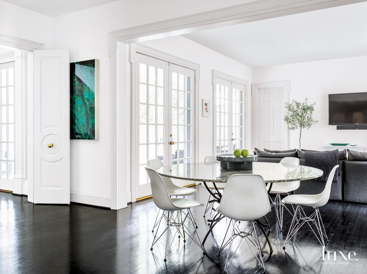 Modern White Breakfast Area with Molded Plastic Chairs