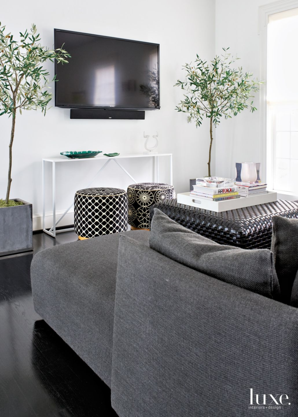 Modern White Family Room with Embroidered Stools