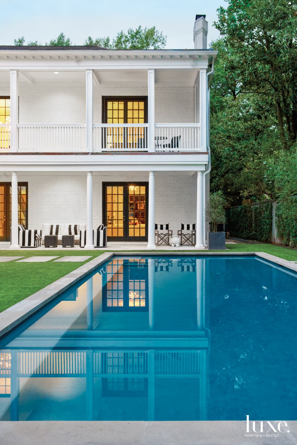Modern White Exterior with Striped Outdoor Furniture