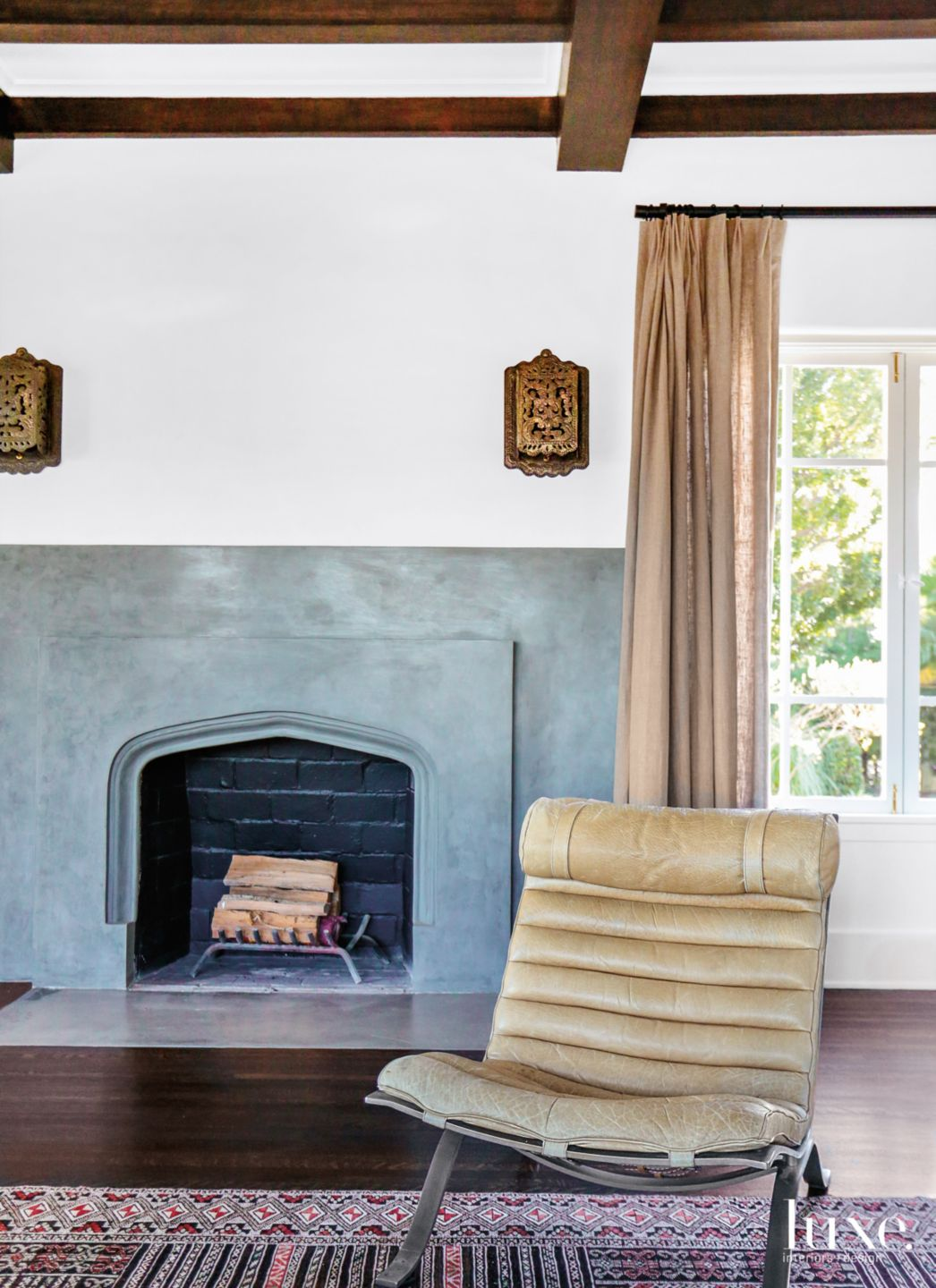 Eclectic White Living Room Vignette with Gray Plaster Fireplace