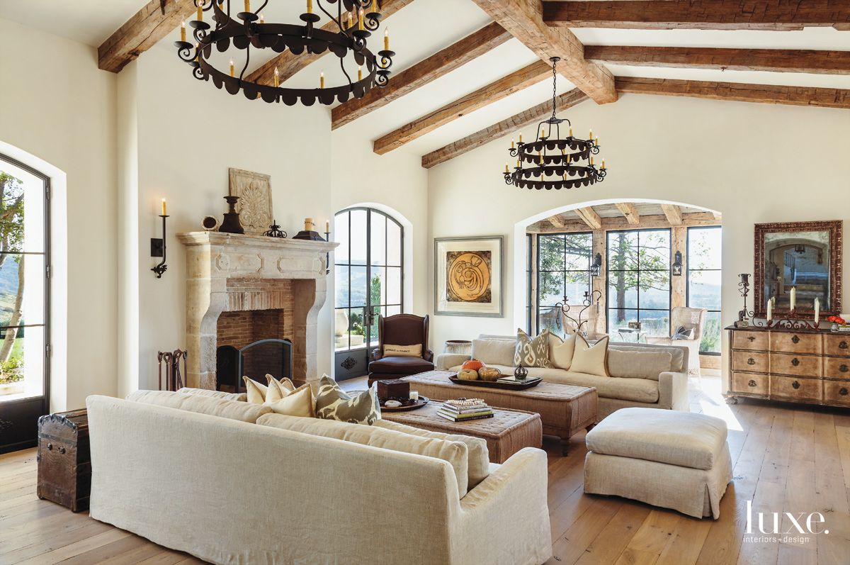 Traditional Cream Family Room with Fabric-Covered Tables