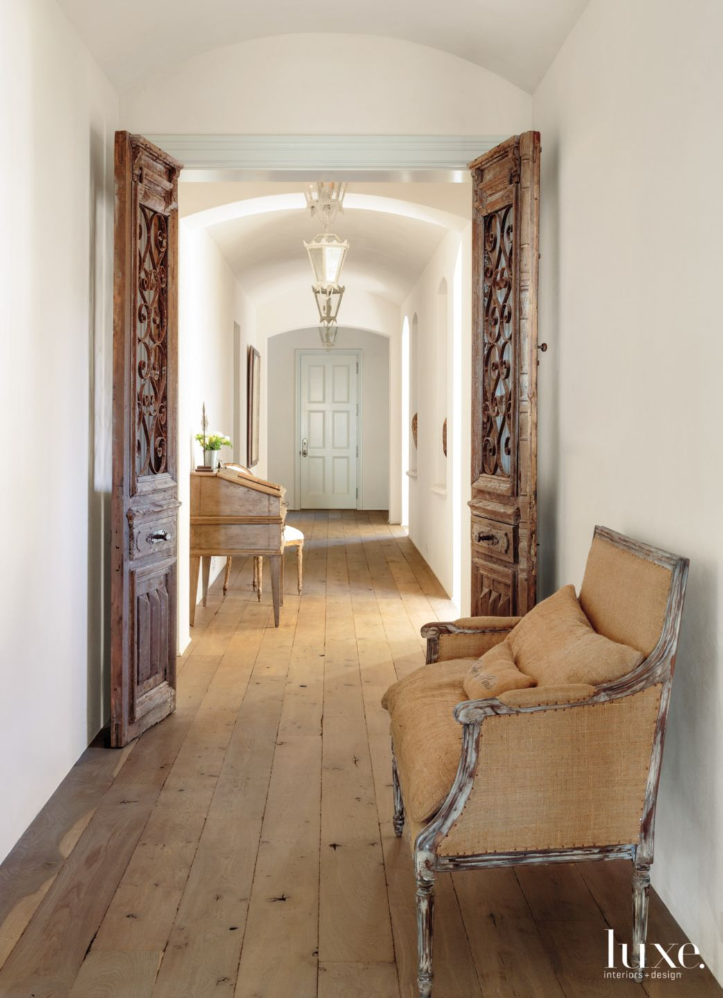Traditional White Hallway with Barrel Ceiling