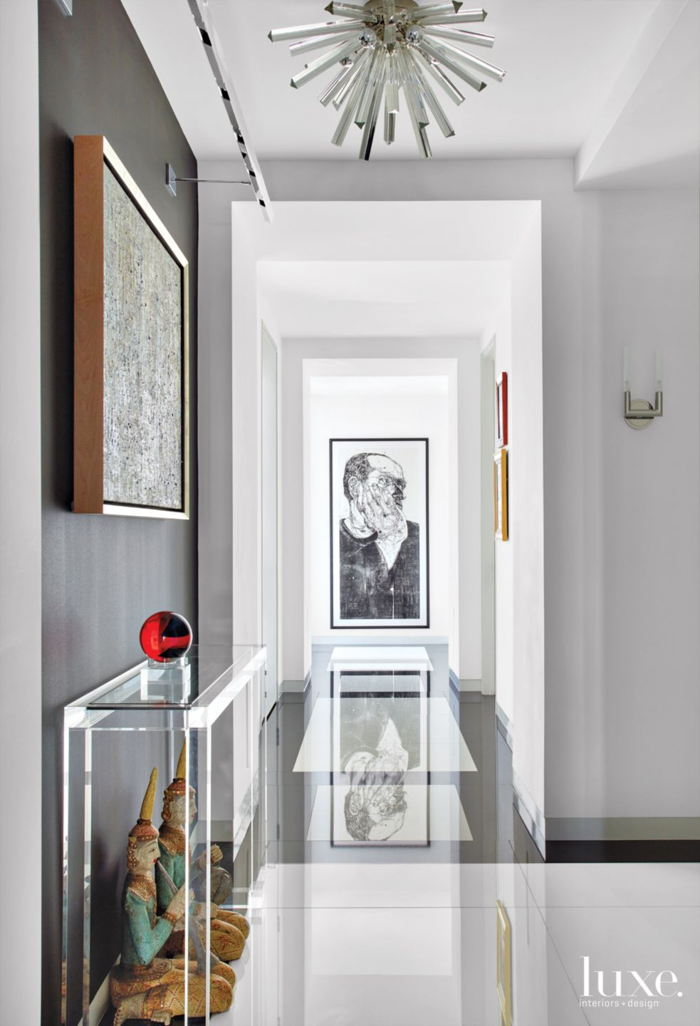 Contemporary White Hallway with Black Marble Flooring