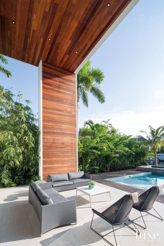 Modern Neutral Outdoor Terrace with Ipe Overhang