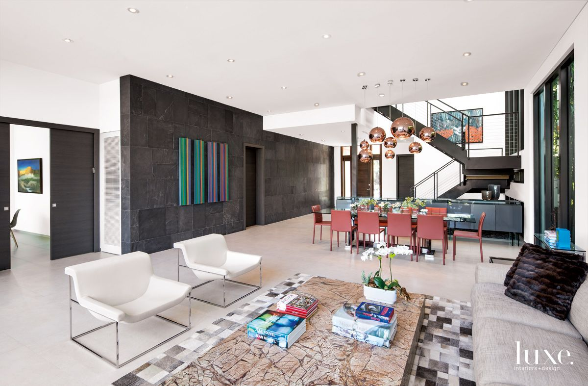 Modern White Living/Dining Area with Slate Wall