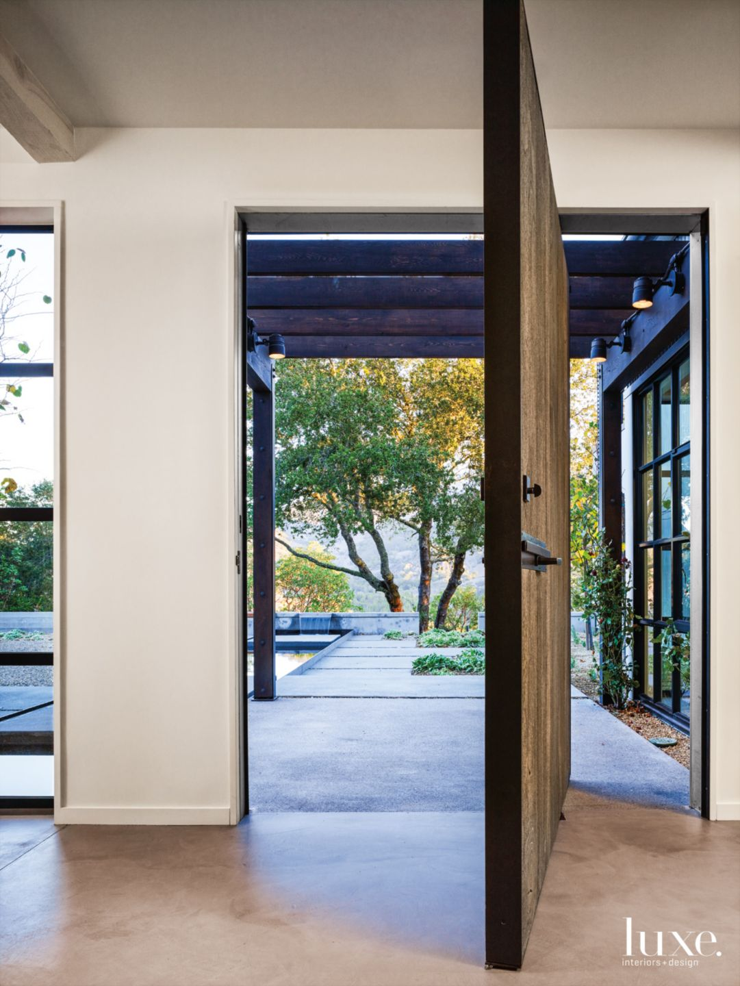 Modern White Front Entry with Custom Wood-and-Steel Door