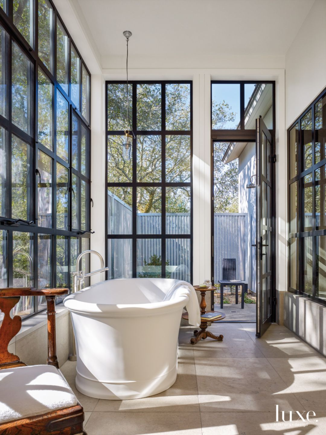 Modern White Bathroom with Aluminum Windows