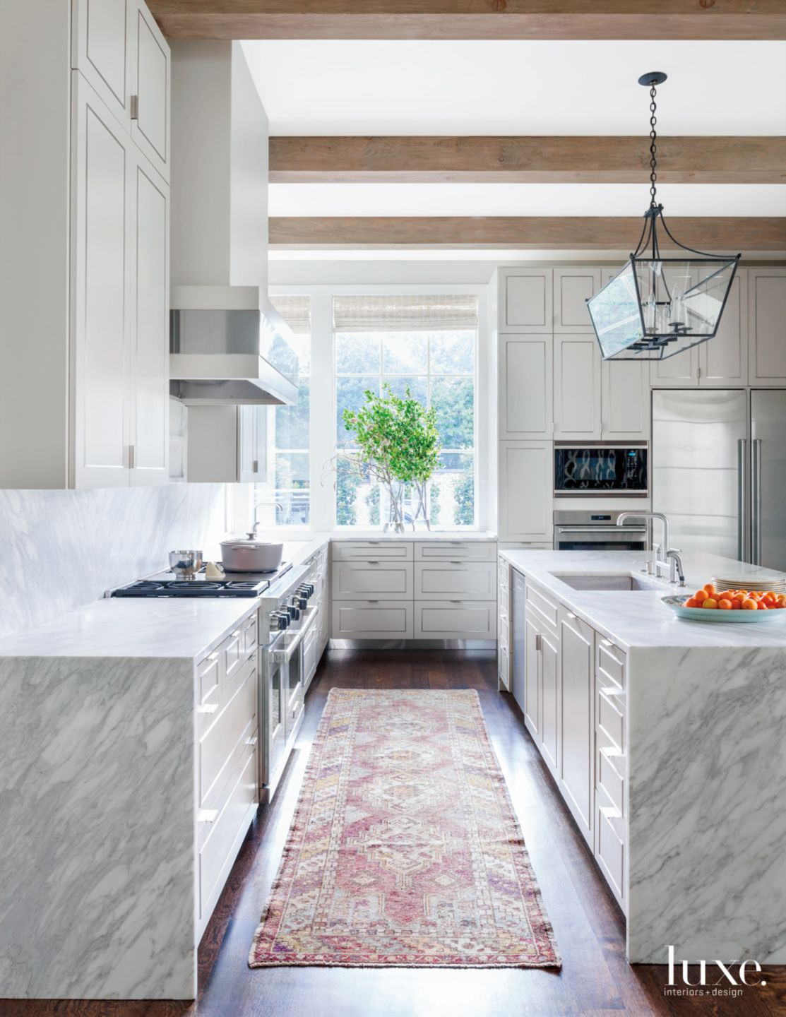 Transitional White Kitchen with Steel-Inlaid Cabinetry