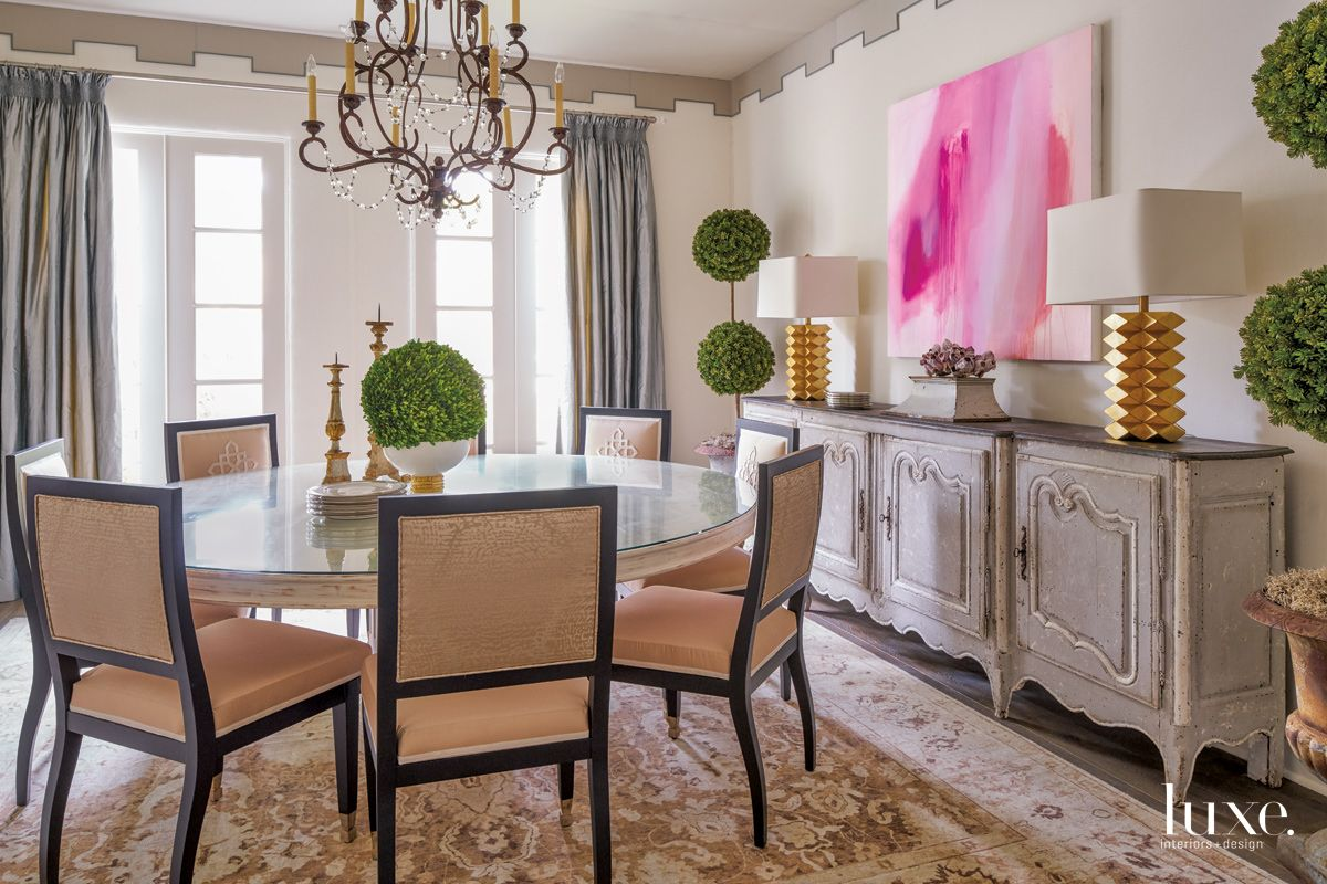 Transitional Cream Dining Room with Bright Pink Painting