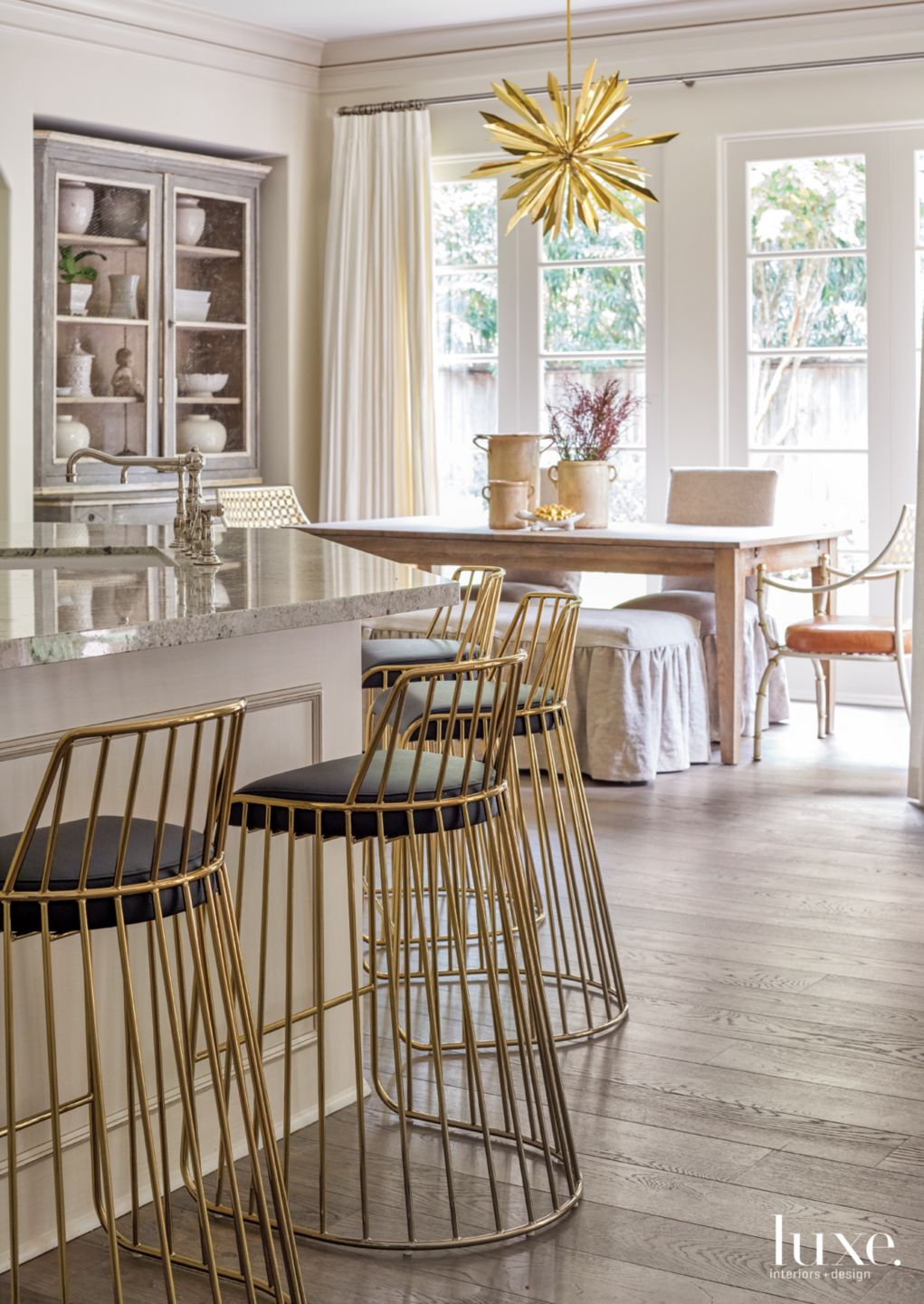 Transitional White Kitchen with Wire-Like Barstools