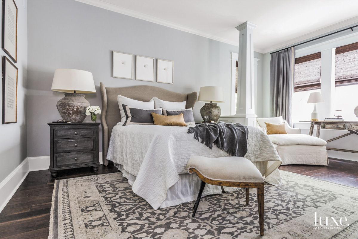 Eclectic White Master Bedroom with Antique Oushak Rug