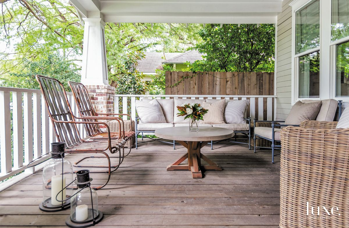 Traditional White Front Porch with Rustic Metal Chairs